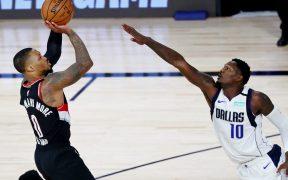 Lillard marcó 61 puntos ante Mavericks, con lo que igualó su mejor marca. (Foto: Reuters)