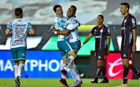 Víctor Dávila consiguió un doblete para el triunfo del León. Foto: Mexsport