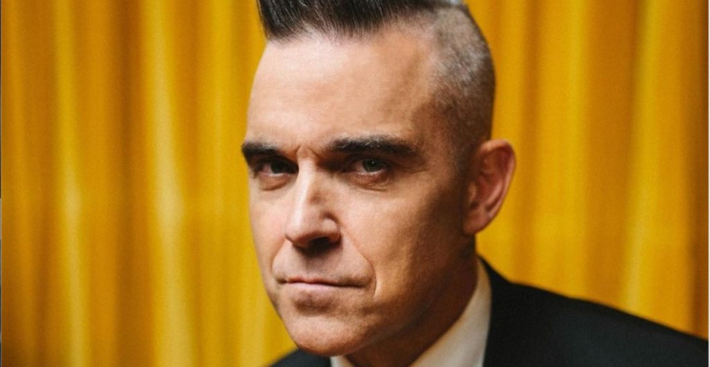 Robbie Williams tendrá película biográfica a cargo de Michael Gracey, director de El Gran Showman
