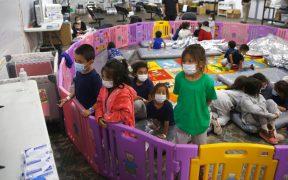 Desciende número de niños migrantes en el mayor albergue de emergencia de EU