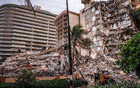 Hallan cuerpos de dos niños entre escombros de edificio en Miami; van 18 muertos