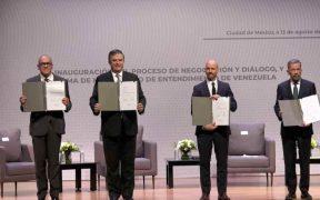 Gobierno de Venezuela y oposición firman acuerdo de negociación pacífica