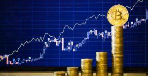 Bitcoin alcanza máximo de 67 mil dólares, un día después de su debut en la bolsa